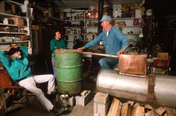 Former_moonshiner_John_Bowman_explaining_the_workings_of_a_moonshine_still_American_Folklife_Center