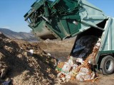 Eco-Cycle truck dumping organic waste at a compost facility. Photo credit: Dan Matsch