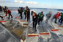 SCRUBBING THE DECKS. (U.S. Navy photo by Mass Communication Specialist 3rd Class Matthew Bookwalter/Released)